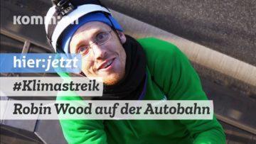 Robin Wood-Kletterer stören Verkehr auf der Autobahn A100 in Berlin
